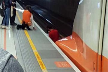 女子摔落高鐵月台 男搭救險遭列車撞上