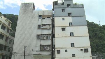 相距不到10公分!兩大樓屋頂「靠緊緊」 找不到屋主簽名難處理
