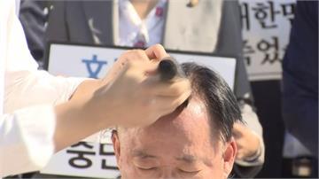 南韓法務部長醜聞頻傳!在野議員剃髮要求下台