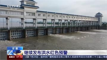 中國長江第三號洪水形成中 官方用隔板阻民眾探水情