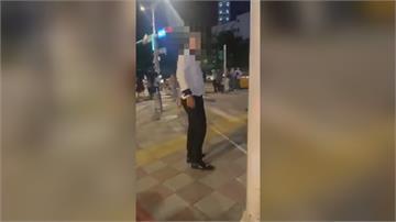 醉男計程車內 對等紅燈女騎士嗆聲男子脫衣推員警 遭警過肩摔壓制送辦